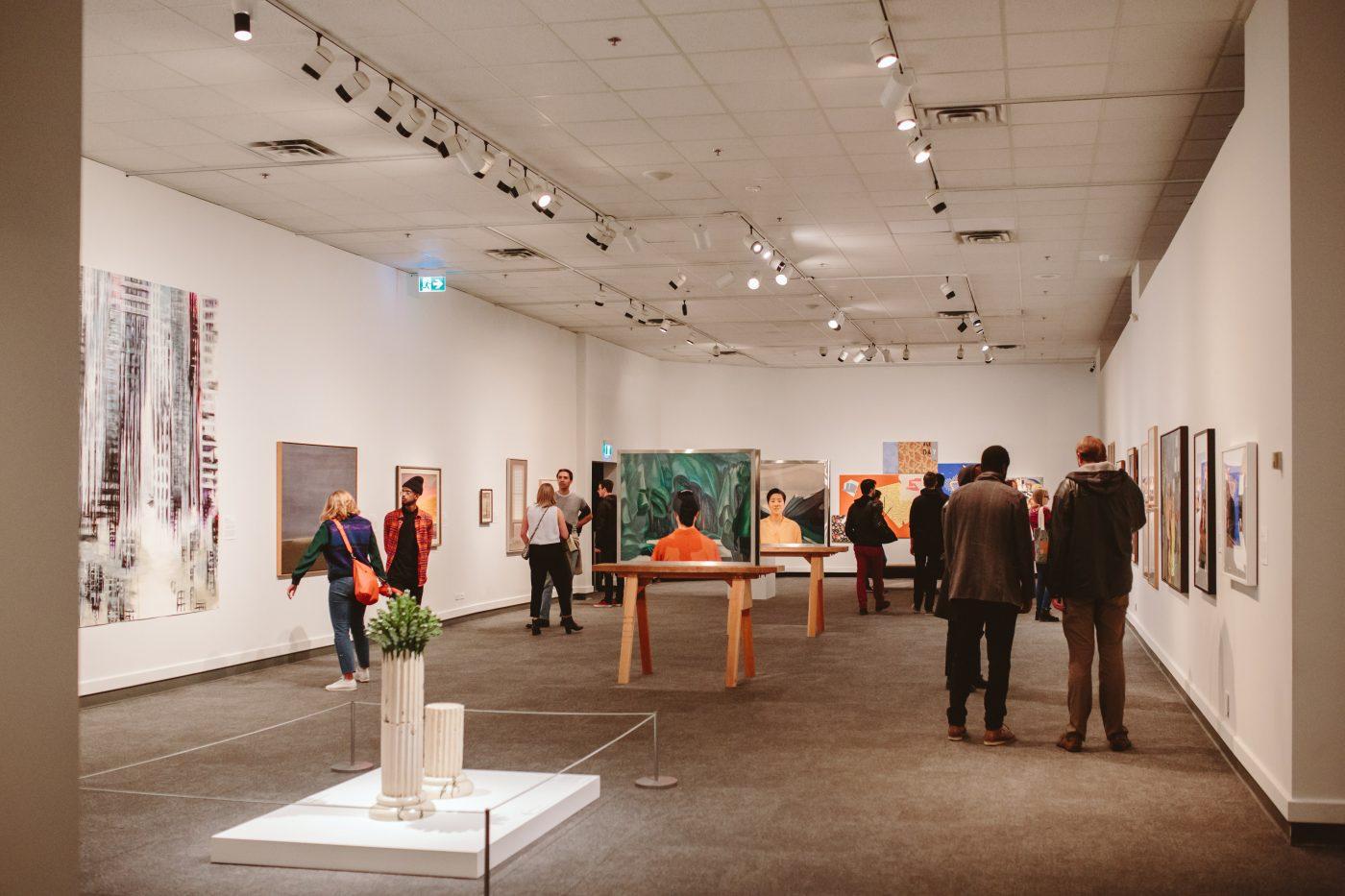 Visitors walk around Glenbow's second floor exhibitions